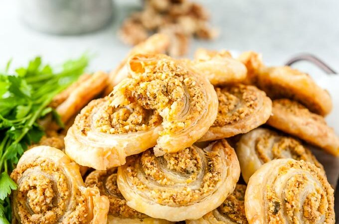 Closeup of Cheesy Pinwheels with Walnuts.