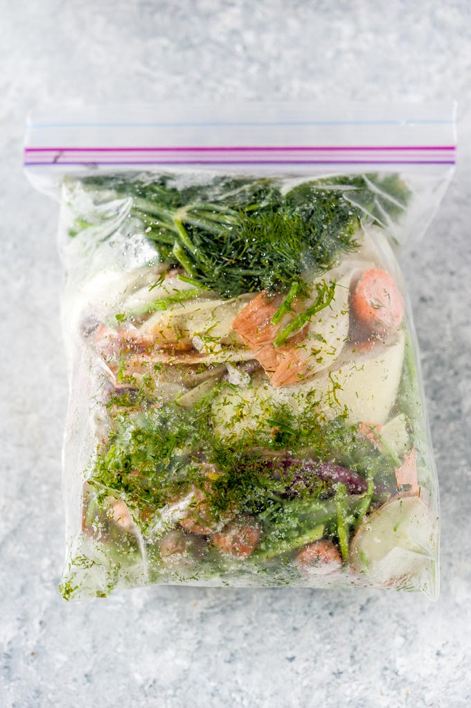 Frozen vegetable scraps in a ziploc bag.