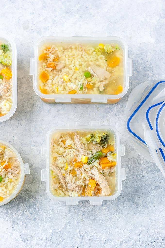 Meal prep containers with chicken noodle soup.