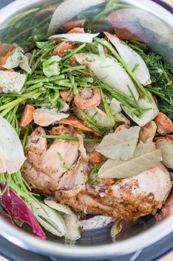 Frozen vegetables and leftover roasted chicken inside Instant Pot.