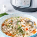 Bowl with Chicken Noodle Soup and Instant Pot in the background.