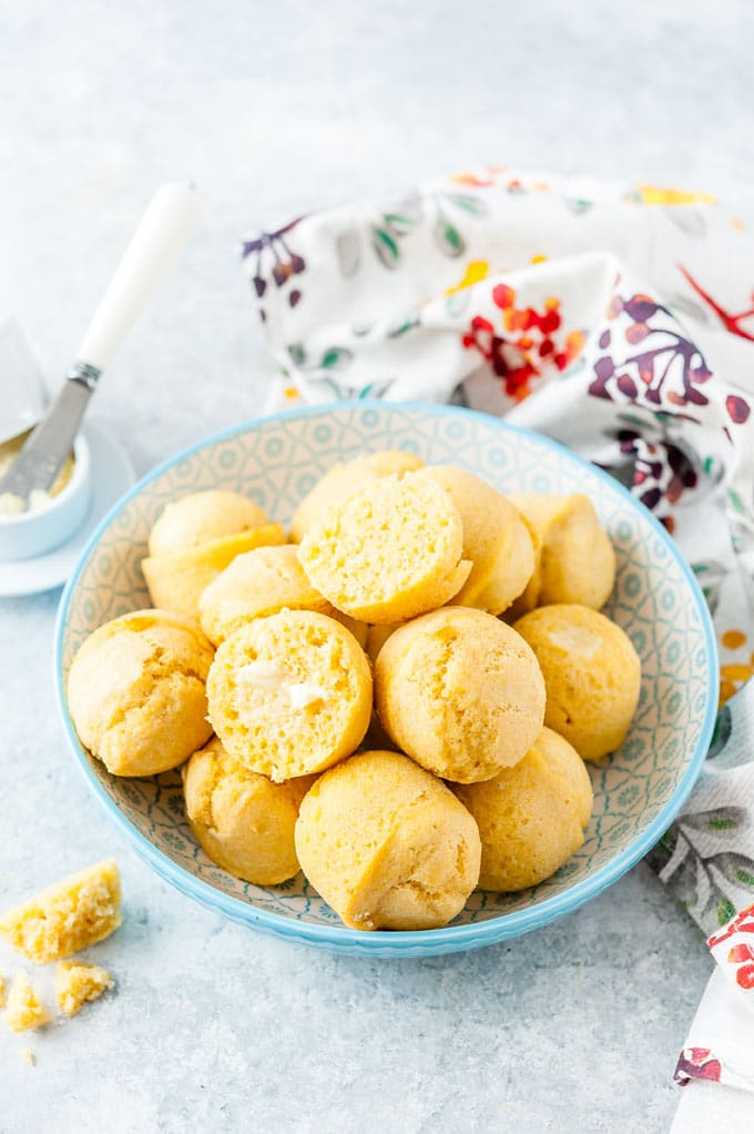 Bowl filled with cornbread muffins.