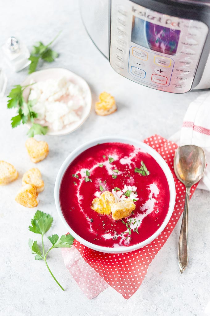Top down view of a bowl of instant pot beet soup.