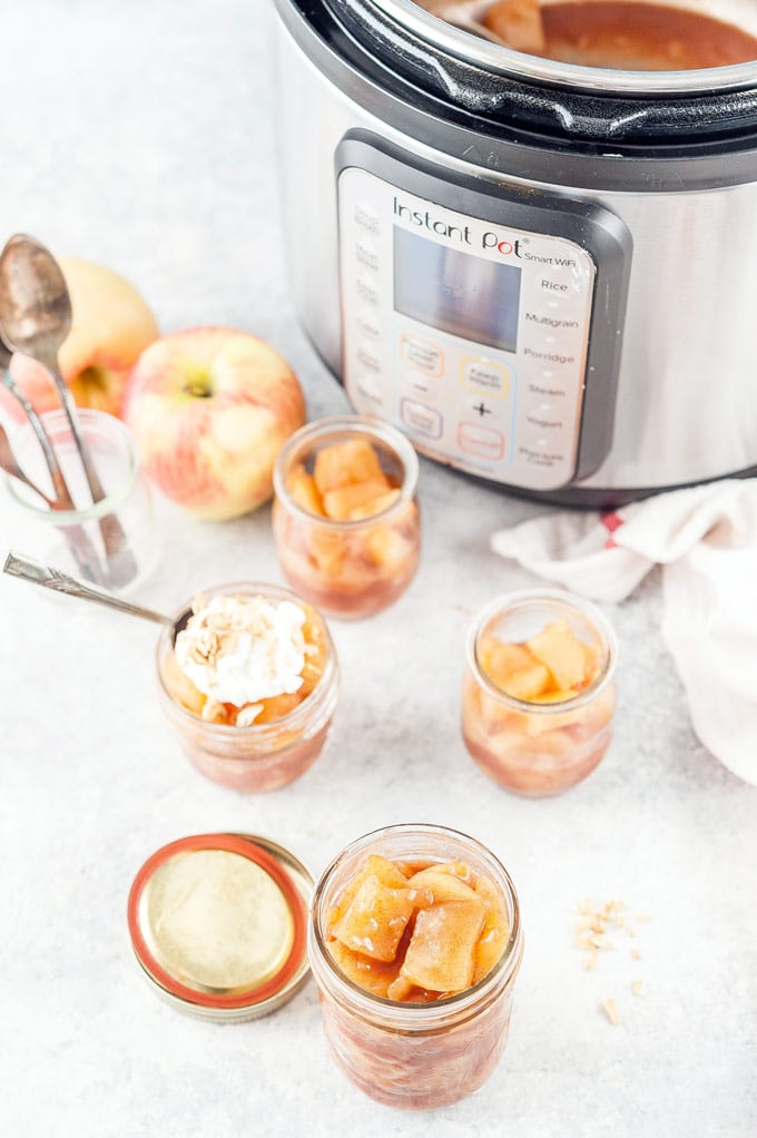 A few jars of apple pie filling and Instant Pot in the background.