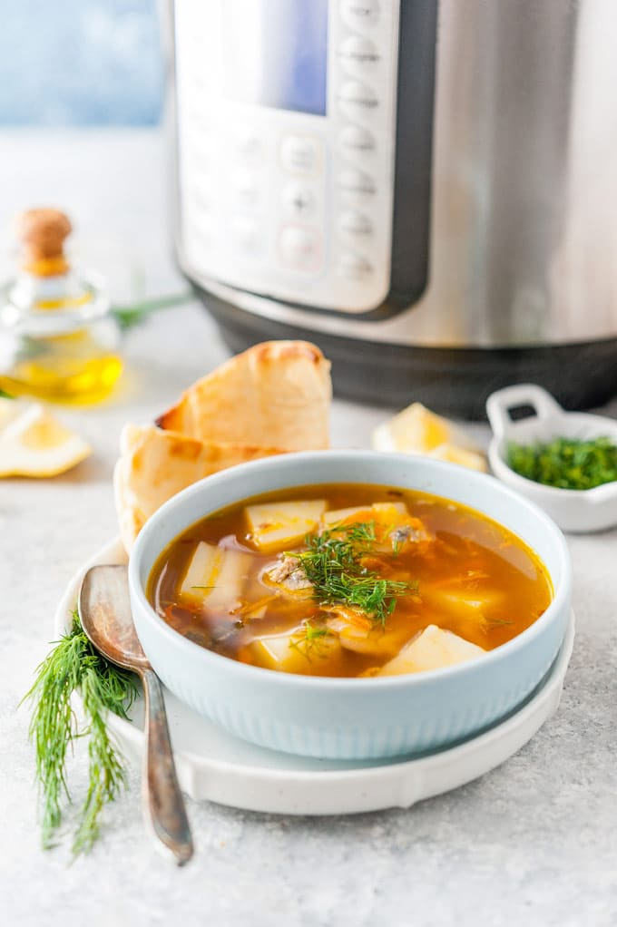 Bowl of soup with Instant Pot in the background.