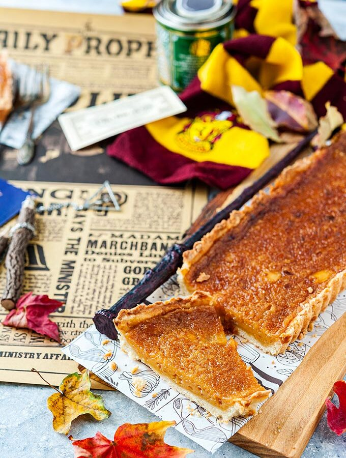 Treacle Tart with a lot of Harry Potter props around it