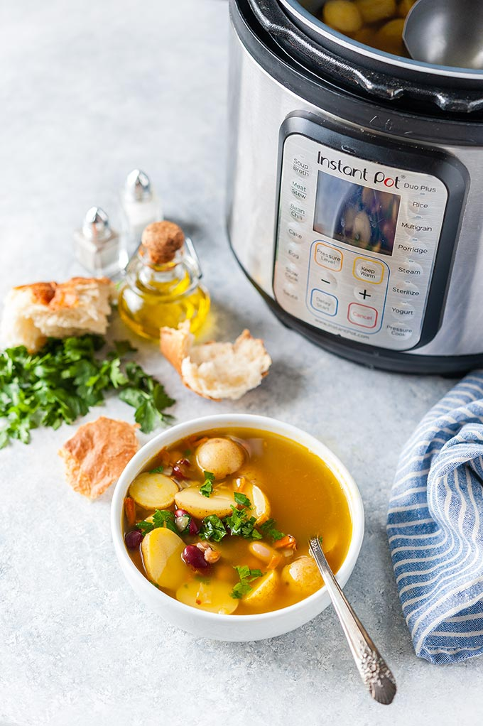 Bowl with soup and Instant Pot.