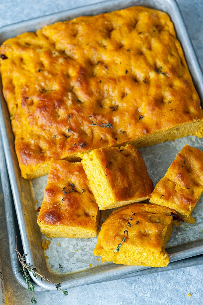 Top down view of a tray with cut up Instant Pot No Knead Pumpkin Focaccia.