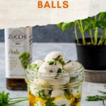 Marinated Mozzarella Balls (Bocconcini) are a simple and delicious appetiser. Perfect for holidays or as a gift. Easy to make and fun to add a bit of variety to a traditional cheese platter | imagelicious.com #marinatedmozzarella #bocconcini #sponsored